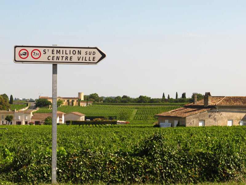 St Emilion sign and vineyards