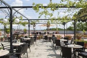 Outdoor patio at Hotel Garden, Siena