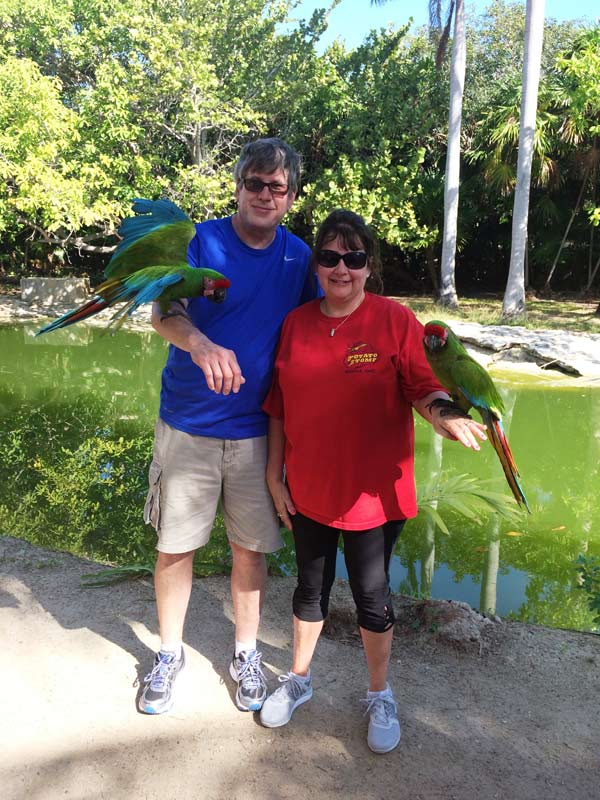 couple with parrots in Mexico