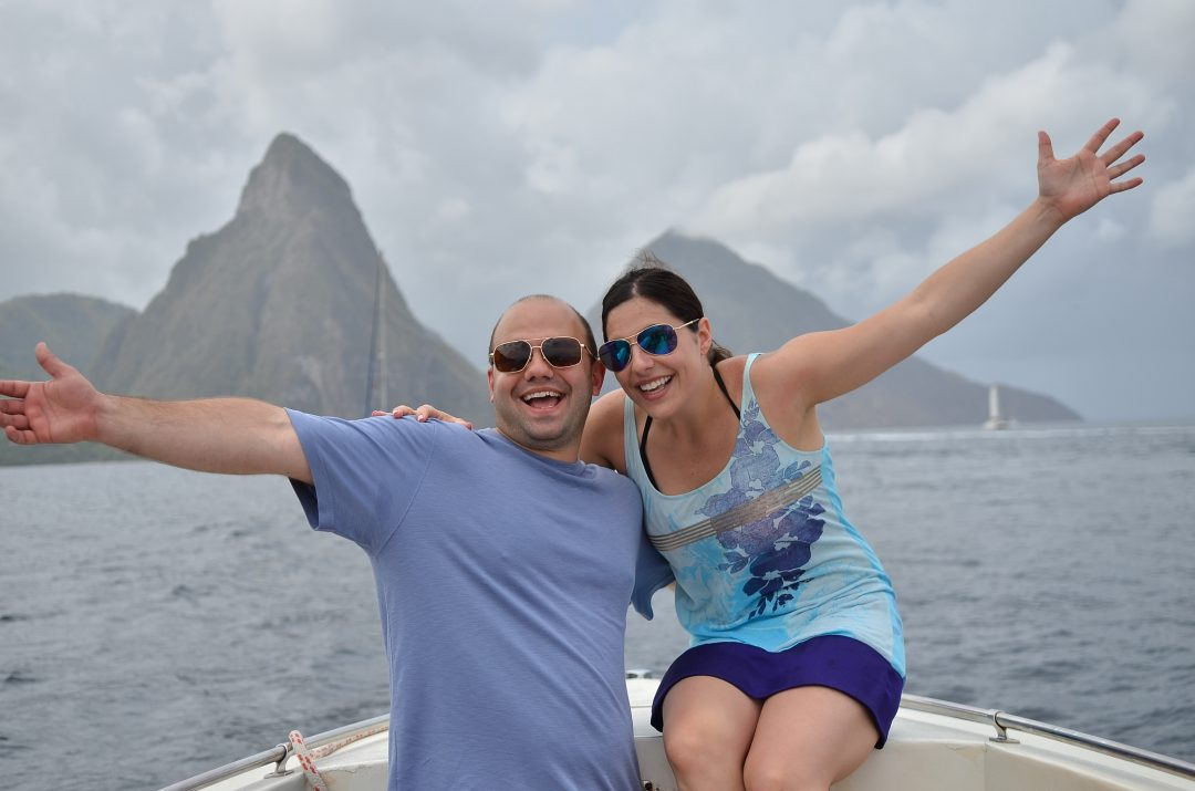 Honeymoon couple with Pitons behind, St. Lucia